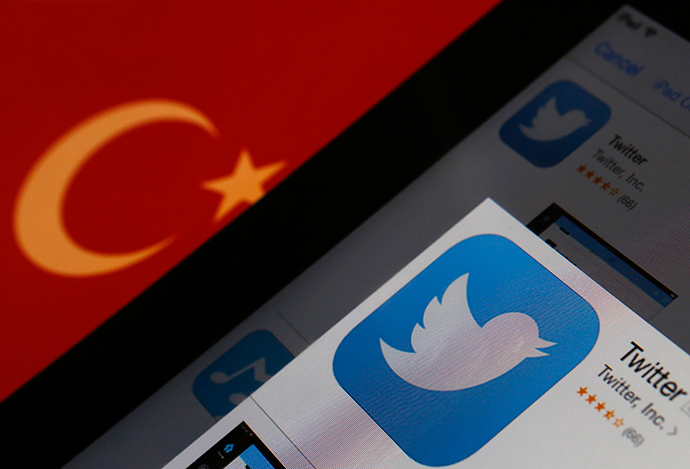A Twitter logo on an iPad display is pictured next to a Turkish flag in this photo illustration taken in Istanbul March 21, 2014 (Reuters / Murad Sezer)