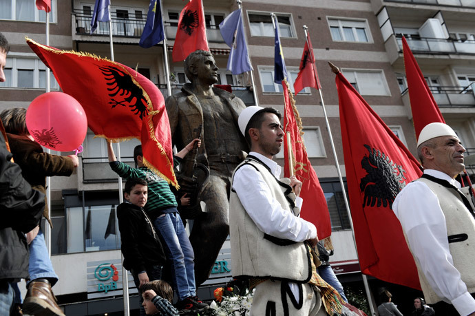 Kosovars hold Albanian flags as they take part in celebrations marking the 6th anniversary of Kosovo's declaration of independence from Serbia, in Pristina on February 17, 2014. (AFP Photo / Armend Nimani)
