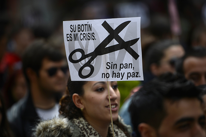 Students demonstrate in the streets of Madrid on March 27, 2014 marking the second day of strikes against the government's cuts in education spending. (AFP Photo / Pierre-Philippe Marcou)