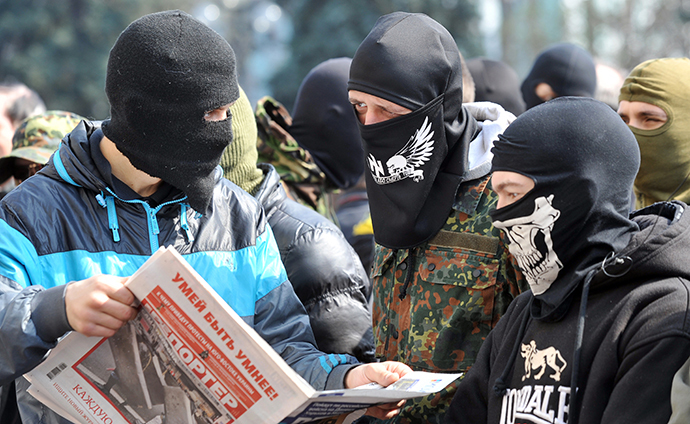 Supporters of the right wing party Pravyi Sector (Right Sector) read newspaper as they protest in front of the Ukrainian parliament in Kiev on March 28, 2014. (AFP Photo / Genya Savilov)