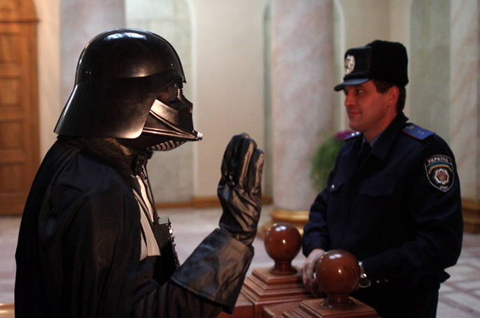 A Ukrainian wearing a Darth Vader costume speaks to a policeman in the city hall of the southern Ukrainian city of Odessa (AFP Photo)