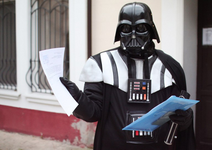 A Ukrainian wearing a Darth Vader costume shows papers outside the city hall of the southern Ukrainian city of Odessa (AFP Photo)