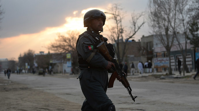 An Afghan policeman stands guard near a guesthouse attack by Taliban fighters in Kabul on March 28, 2014.(AFP Photo / Shah Marai)