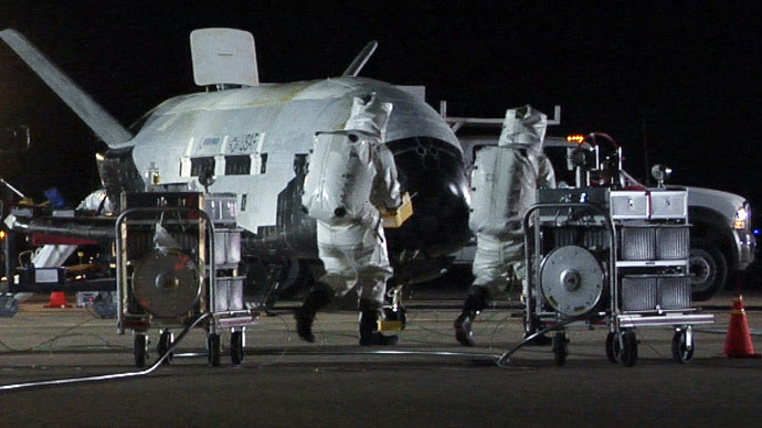 Technicians conduct post-landing operations on the X-37B Orbital Test Vehicle at Vandenberg Air Force Base, California in this U.S. Air Force handout photo dated December 3, 2010.(Reuters / U.S. Air Force)