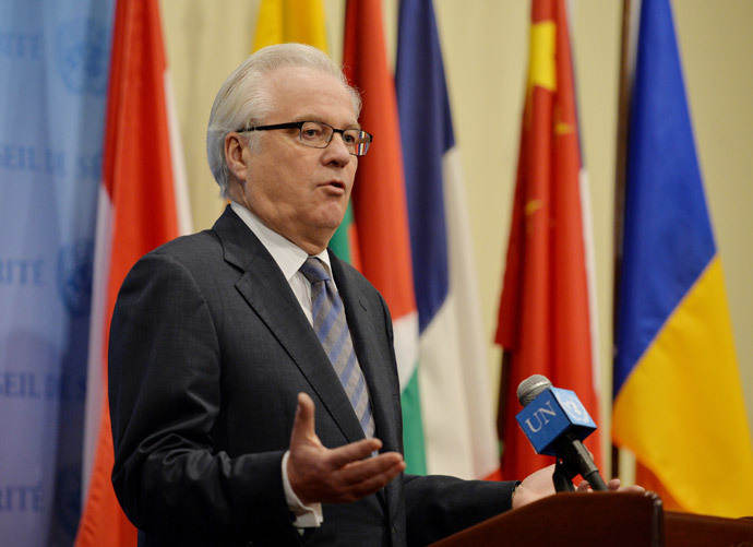Vitaly Churkin, Russia's Ambassador to the United Nations, speaks to the media after a closed-door session of the Security Council to discuss the situation in Ukraine March 28, 2014 at UN headquarters in New York.(AFP Photo / Stan Honda)