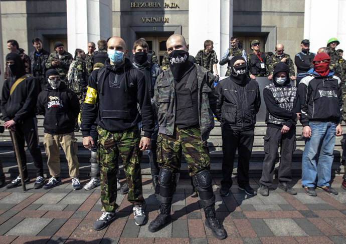 Members of the Ukrainian far-right radical group Right Sector stand outside the parliament in Kiev March 28, 2014. (Reuters/Valentyn Ogirenko)