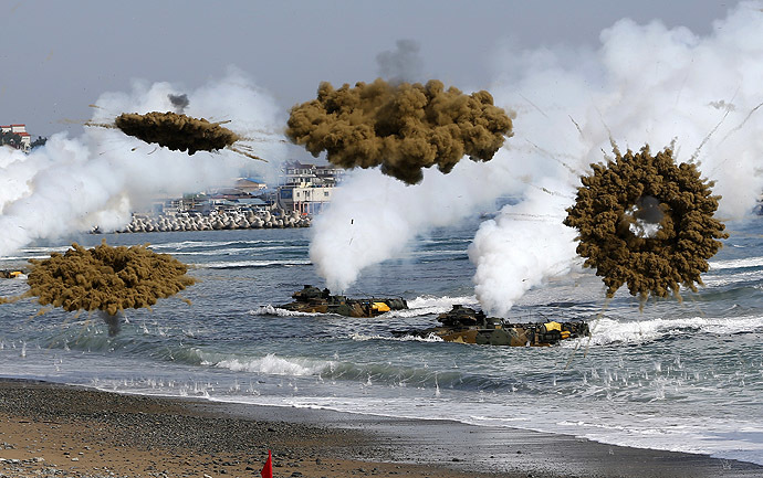 Amphibious assault vehicles of the South Korean Marine Corps throw smoke bombs as they move to land on shore during a U.S.-South Korea joint landing operation drill in Pohang March 31, 2014. (Reuters/Kim Hong-Ji)