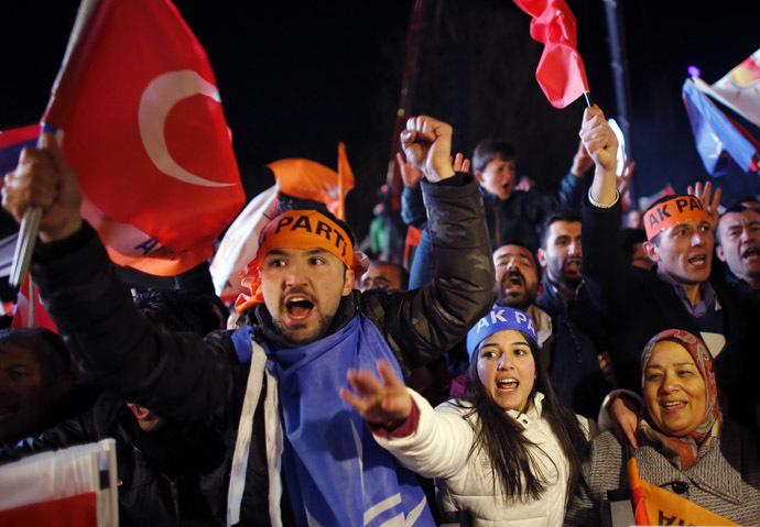 Supporters of the ruling AK Party wave Turkish flags as they wait for the arrival of Turkish Prime Minister Tayyip Erdogan at the party's headquarters in Ankara March 30, 2014. (Reuters/Umit Bektas)