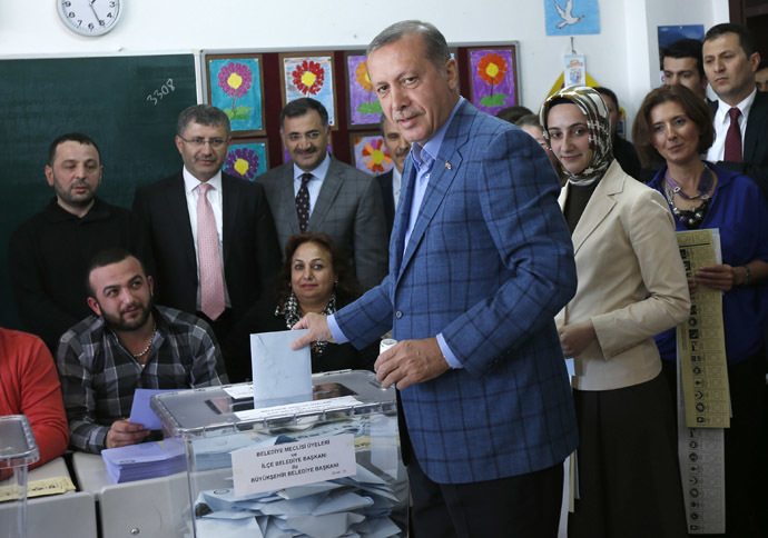 Turkey's Prime Minister Tayyip Erdogan casts his ballot at a polling station during the municipal elections in Istanbul March 30, 2014. (Reuters/Murad Sezer)