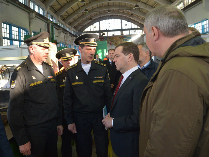 Russia's Prime Minister Dmitry Medvedev (2nd R) visits the 13th Ship-Repairing Yard of Russian Black Sea Fleet in Sevastopol, on March 31, 2014, with Russian deputy prime minister Dmitry Rogozin (R), who oversees the defence sector, accompanying Medvedev. (AFP Photo / Alexander Astafyev)