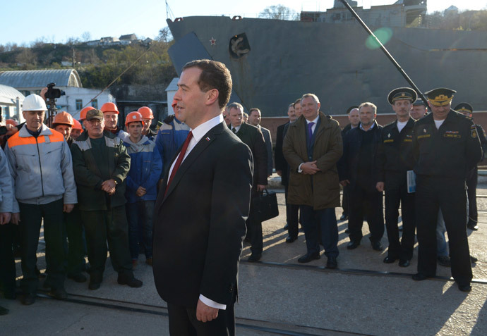 Russia's Prime Minister Dmitry Medvedev (C) visits the 13th Ship-Repairing Yard of Russian Black Sea Fleet in Sevastopol, on March 31, 2014.(AFP Photo / Alexander Astafyev)