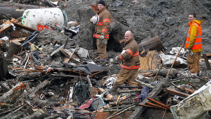 Rescuers face dangerous toxins in Washington state mudslide recovery operation