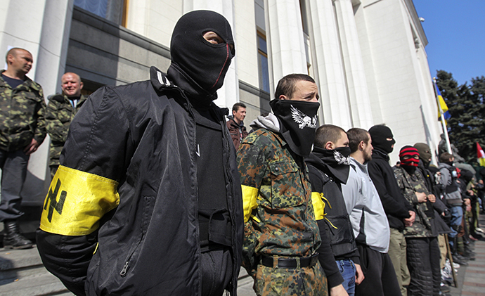 Members of the Ukrainian far-right radical group Right Sector stand outside the parliament in Kiev March 28, 2014. (Reuters / Valentyn Ogirenko)