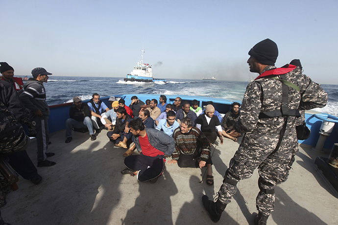 Crew members of the Morning Glory are brought to Tripoli port, March 23, 2014. (Reuters / Hani Amara)