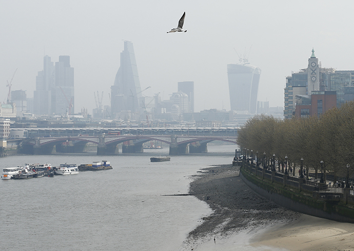 A seagull flies above the skyline of the City of London April 2, 2014. (Reuters / Olivia Harris)