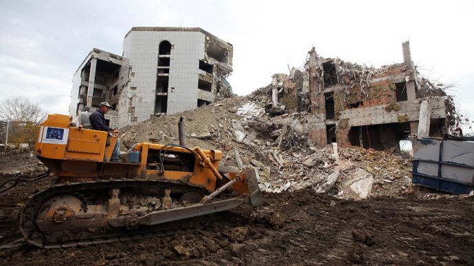 A worker operates a bulldozer during the demolition of the former Chinese embassy in Belgrade November 10, 2010.(Reuters / Marko Djurica)