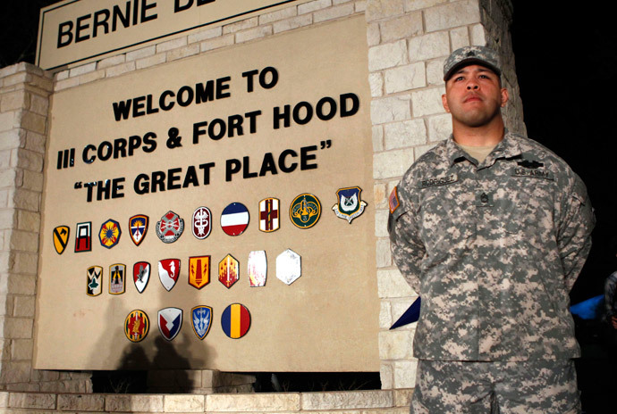 Sgt. First Class Erick Rodriguez stands guard before a news conference by Lt. Gen. Mark Milley at the entrance to Fort Hood Army Post in Texas April 2, 2014. (Reuters / Erich Schlegel)
