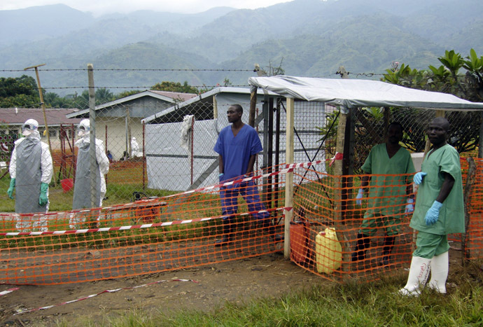 Health workers, some of whom have been disinfected, stand at the entrance of the isolation ward for Ebola suspected patients at Bundibugyo hospital in Uganda December 11, 2007 (Reuters)