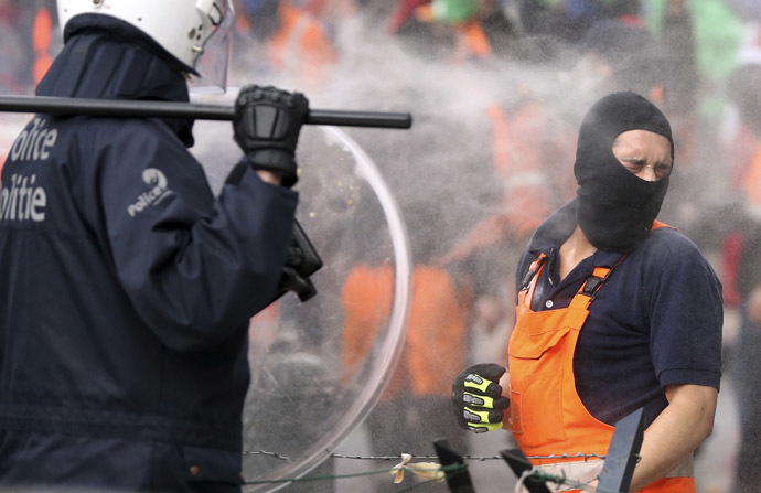 A demonstrator is sprayed by tear gas during a European trade union protest against austerity measures, in central Brussels April 4, 2014. (Reuters/Francois Lenoir)