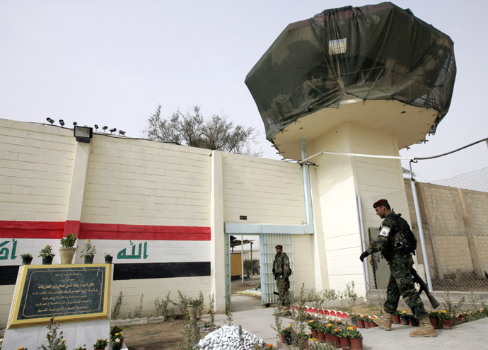 An Iraqi soldier walks near a watch tower of the Baghdad Central Prison in Baghdad's Abu Ghraib (Reuters)