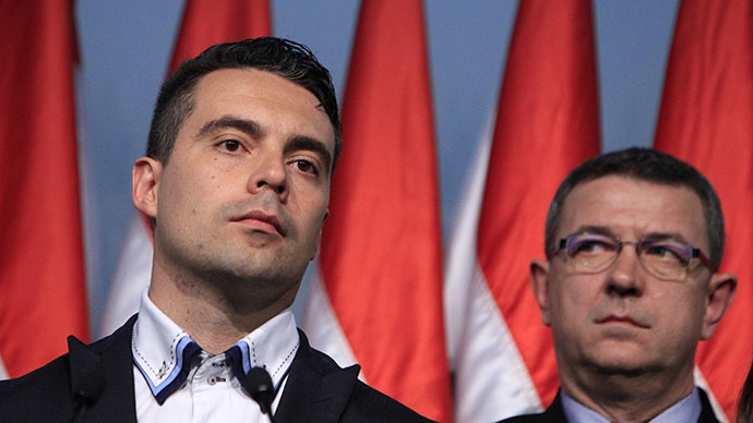 Gabor Vona, the chairman of the far-right Jobbik party, (L) reacts as he addresses to supporters after partial results of parliamentary elections are announced in Budapest April 6, 2014. (Reuters / Bernadett Szabo)