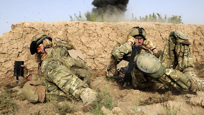 British soldiers take cover as they shelter from a controlled explosion of an Improvised Explosive Device (IED) in a village of Sayedebad District, Nad e Ali, Helmand Province on July 31, 2010 (AFP Photo / Ministry of Defence / Corporal Barry Lloyd RLC)