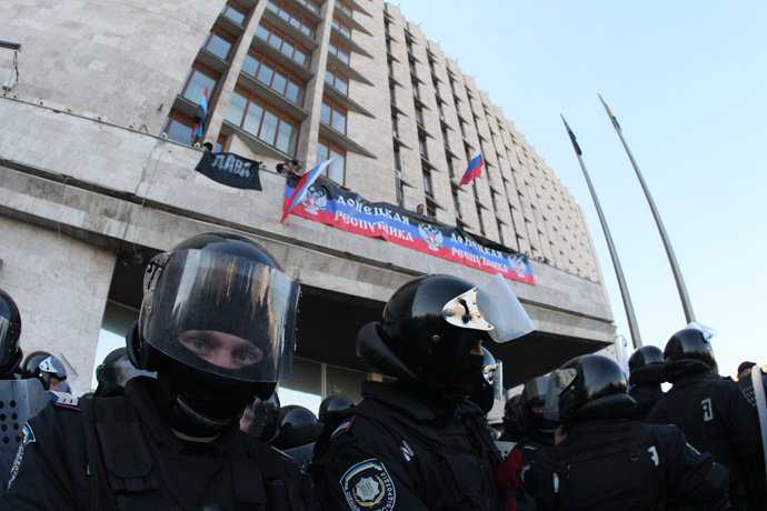 Pro-Russian supporters deploy a Russian flag and the flag of the so-called Donetsk Republica as they storm the regional administration building in the eastern Ukrainian city of Donetsk on April 6, 2014 (AFP Photo / Alexandr Khudoteply)