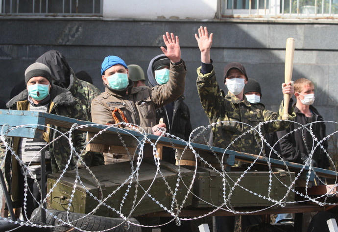 Pro-Russian activists guard a barricade set at the Ukrainian regional Security Service building on the eastern city of Donetsk on April 7, 2014.(AFP Photo / Alexander Khudoteply)