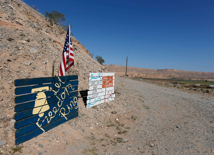 Signs sit at the entrance of a ranch protesting against the Bureau of Land Management's (BLM) decision to temporarily close access to thousands of acres of BLM land to round up illegal cattle that are grazing, south of Mesquite, Nevada, April 7, 2014. (Reuters / George Frey)