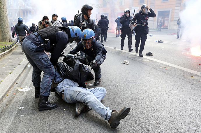 A demonstrator is detained by policemen during a protest in downtown Rome April 12, 2014. (Reuters / Alessandro Bianchi)