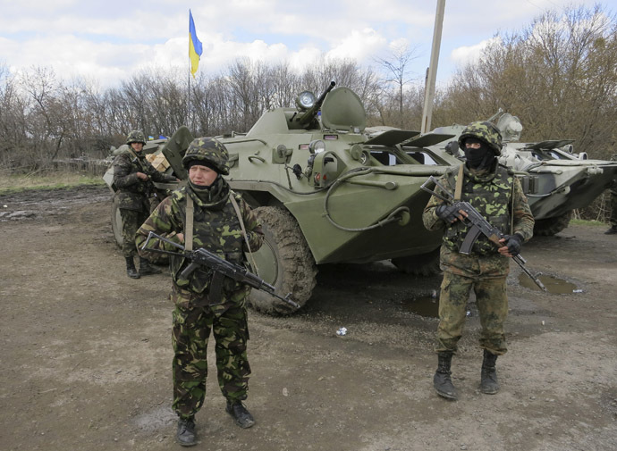 Ukrainian soldiers are seen near armored personnel carriers at a checkpoint near the town of Izium in Eastern Ukraine, April 15, 2014. (Reuters / Dmitry Madorsky)