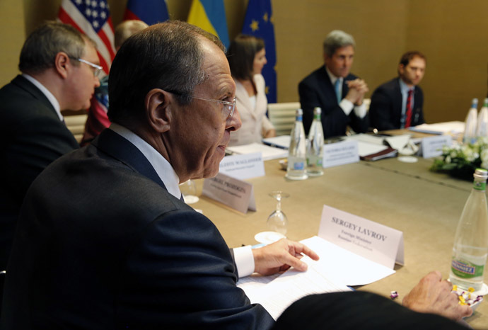 Russia's Foreign Minister Sergei Lavrov (L) looks on as U.S. Secretary of State John Kerry (2nd R) starts a quadrilateral meeting in Geneva, between representatives of the U.S., Ukraine, Russia and the European Union about the ongoing situation in Ukraine April 17, 2014. (Reuters/Jim Bourg)