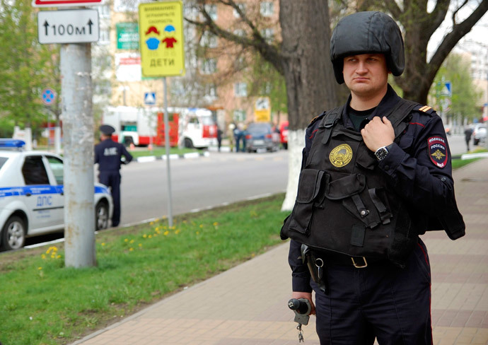 An Interior Ministry member stands guard as he blocks the way near an office of Zapadny bank in Belgorod April 21, 2014.(Reuters / Vladimir Kornev)