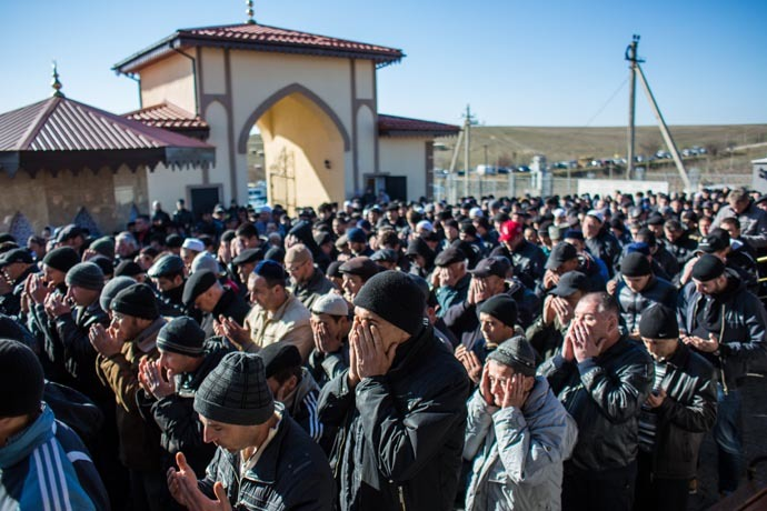 Crimean Tatars pray during a traditional funeral ceremony at the Abdal Muslim Cemetery in Simferopol. (RIA Novosti/Andrey Stenin)