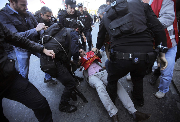 Riot police detain a union member during a protest against the government ban of May Day gathering in Taksim square in central Istanbul April 21, 2014. (Reuters)