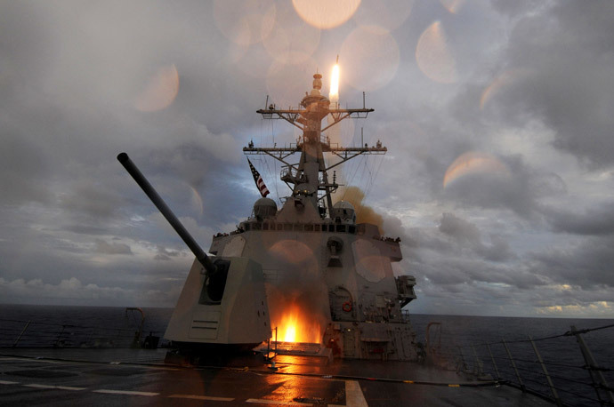 The guided-missile destroyer USS Mustin (DDG 89) fires a Standard Missile 2 (SM-2) missile from the ship's forward and aft missile decks during a missile exercise in the Pacific Ocean (Reuters / Devon Dow / U.S. Navy photo / Handout)
