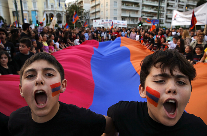 Armenian boys shout slogans against Turkey in front of a huge Armenian flag during a demonstration near the Turkish embassy in central Athens, April 24, 2013. (Reuters / Yannis Behrakis)