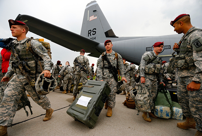 Soldiers from the first company-sized contingent of about 150 U.S. paratroopers from the U.S. Army's 173rd Infantry Brigade Combat Team based in Italy walk after unpacking as they arrive to participate in training exercises with the Polish army in Swidwin, northern west Poland April 23, 2014 (Reuters / Kacper Pempel)