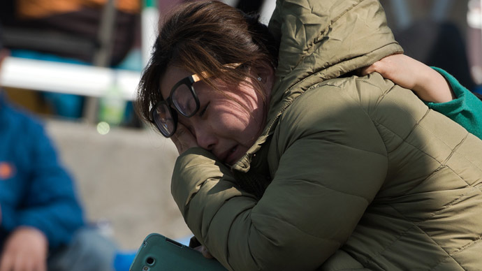 "A woman reacts after the body of a relative was recovered and identified from the capsized South Korean ferry ""Sewol"" at an area where family members of victims of the disaster are gathered at Jindo harbour (AFP Photo/Nicolas Asfouri)"