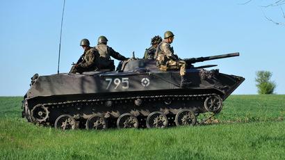Airborne gunmen attack Ukrainian militia checkpoint near weapons depot