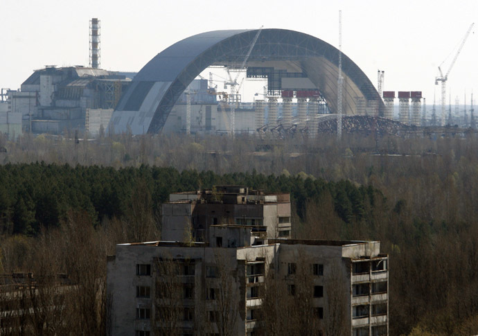 The first half of the Chernobyl New Safe Confinement, or NSC, an arch that which will cover the reactor building, is seen after it was pushed to its site at the Chernobyl Nuclear Power plant on April 3, 2014. (AFP Photo/Anatoly Stepanov)