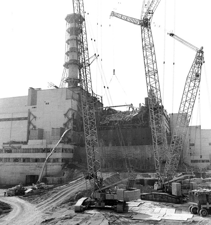The building of the sarcophagus around the fourth reactor of the Chernobyl nuclear power plant after its explosion is seen in this 1986 file photo. (Reuters)