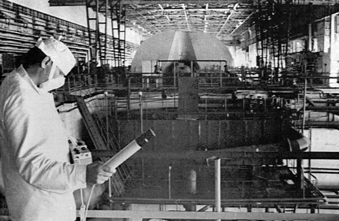 A worker at the Chernobyl nuclear power plant checks the radiation level in the engine room of the first and second power units in this June 5, 1986 file photo. (Reuters)