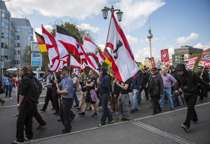 Activists from the far right party NPD march across the Jannowitz bridge in Berlin on April 26, 2014. (AFP Photo/Odd Andersen)