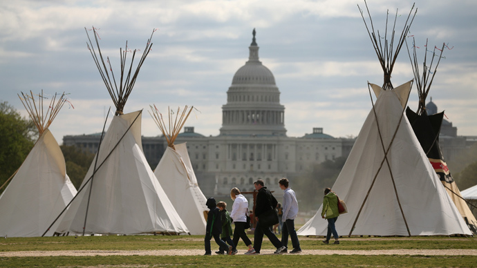 People walk past Indian Teepees that are on the National Mall as part of a protest against the Keystone pipeline April 23, 2014 in Washington, DC (AFP Photo / Mark Wilson)