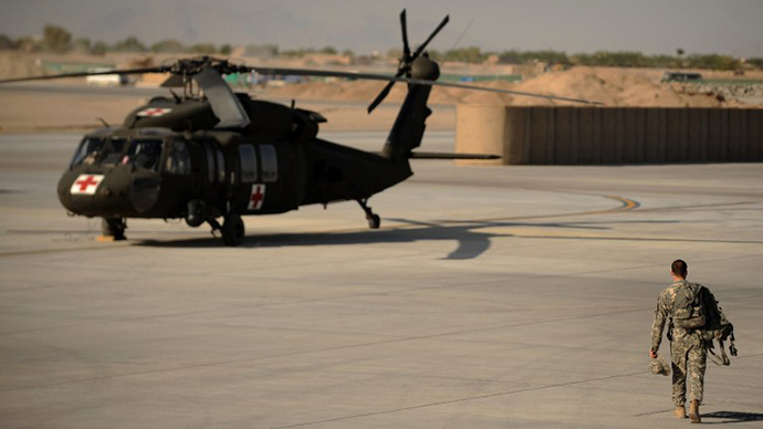 A US army soldier from Company C,1st Battalion, 52nd Aviation Regiment, MEDEVAC team walks over to a Blackhawk helicopter at southern Kandahar airfield (AFP Photo / Peter Parks)