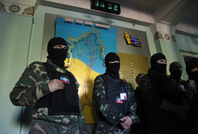 Masked activists stand guard a regional television station in the eastern Ukrainian city of Donetsk, on April 27, 2014. (AFP Photo / Anatoliy Stepanov)