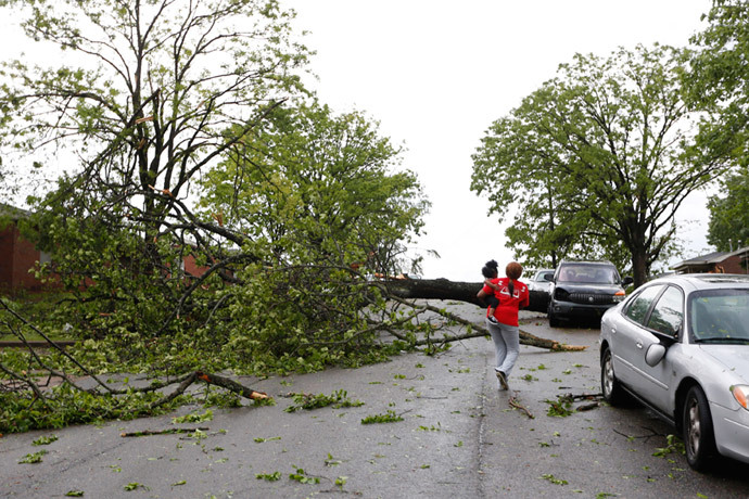 A resident walks by a downed tree along Madison Street after a tornado went through Tupelo, Mississippi April 28, 2014. (Reuters / Lauren Wood)