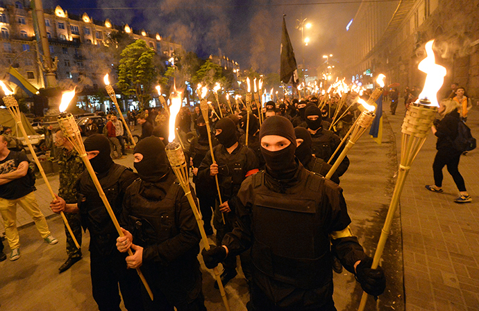 "Unknown ultra-nationalists activists march towards the Independence Square to commemorate ""Maidan heroes"" in Kiev on April 29, 2014. (AFP Photo / Sergey Supinsky)"