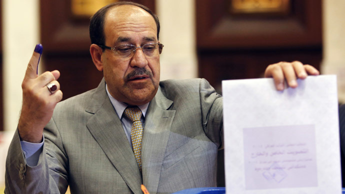 Iraq's Prime Minister Nouri al-Maliki casts his ballot during parliamentary election in Baghdad April 30, 2014. (Reuters/Ahmed Jadallah)